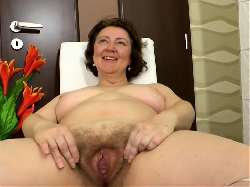 Mature woman with spreads her legs and shows her big fleshy